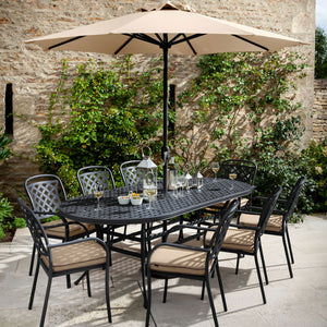 2019 Hartman Berkeley 8 Seater Oval Garden Dining Table Set In Situ With Outdoor Dining Chairs And An Open Solar Parasol