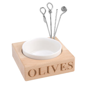 Olive dish with four picks in wooden block