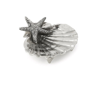 Scallop shell dish in silver on white background