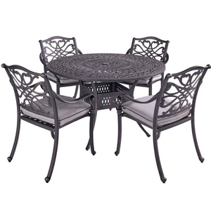 2019 Hartman Capri 4 Seater Round Garden Dining Table Surrounded By 4 Dining Chairs On A White Background