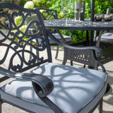 Close Up Of 2019 Hartman Capri Antique Grey Outdoor Dining Chair With Platinum Faux Leather Outdoor Cushion In Situ