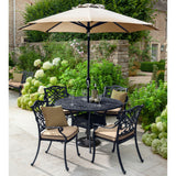 2019 Hartman Capri 4 Seater Bronze Round Garden Dining Table Surrounded by 4 Dining Chairs With An Open Solar Parasol