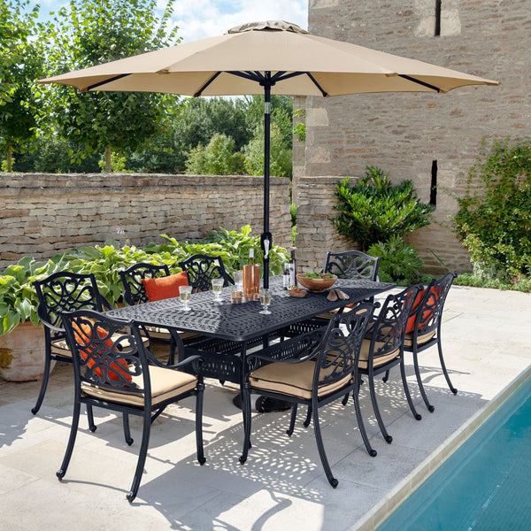 2019 Hartman Capri 8 Seat Rectangular Garden Dining Table Set Next To A Pool With The Solar Parasol Open