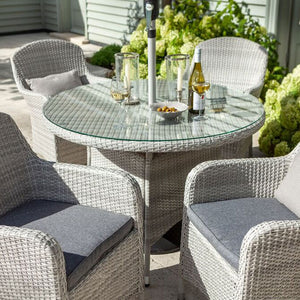 2019 Hartman Curve 4 Seat Round Garden Dining Table Set - Cool Grey / Charcoal with wine and glasses on table