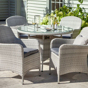 2019 Hartman Curve 4 Seat Round Garden Dining Table Set - Cool Grey / Charcoal on patio in front of house with glasses on table
