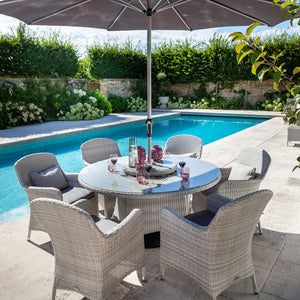 2019 Hartman Curve 6 Seat Round Garden Dining Set With Lazy Susan - Cool Grey / Charcoal on patio next to pool surrounded by plants