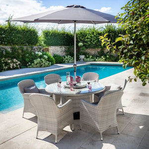 2019 Hartman Curve 6 Seat Round Garden Dining Set With Lazy Susan - Cool Grey / Charcoal on patio next to pool with pink drinks on table