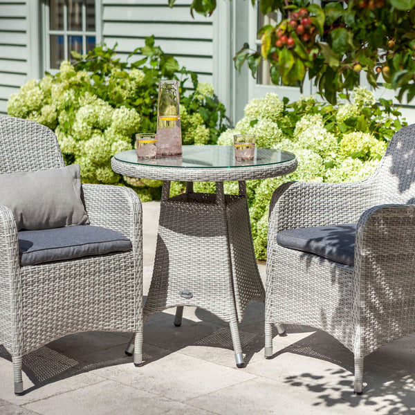 2019 Hartman Curve Garden Bistro Set - Cool Grey / Charcoal table and chairs on patio in front of house with plants