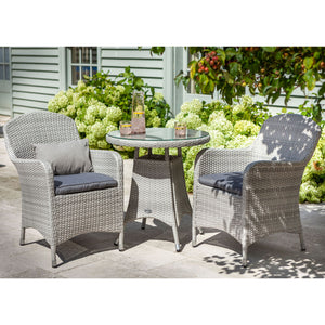 2019 Hartman Curve Garden Bistro Set - Cool Grey / Charcoal wide view of table and chairs on patio in front of house and plants