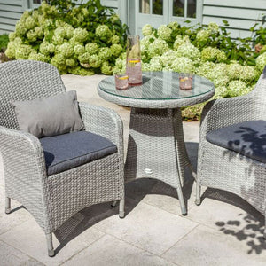 2019 Hartman Curve Garden Bistro Set - Cool Grey / Charcoal close view of table and chairs in front of house and plants