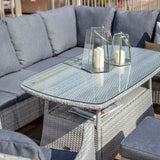 2019 Hartman Curve Rectangular Casual Garden Dining Table Set - Cool Grey / Charcoal candles on table next to sofa