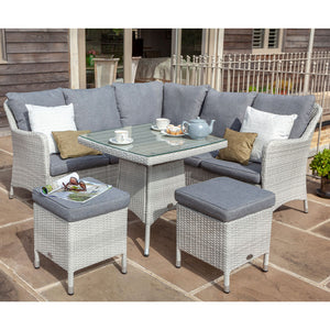 2019 Hartman Curve Square Casual Garden Dining Table Set - Cool Grey / Charcoal on patio in front of wooden house with teapot and cups on table