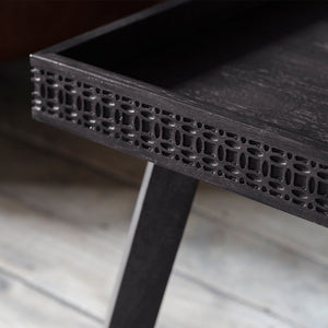Chic Black coffee table edge close up with leg