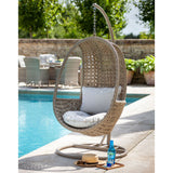 2019 Hartman Heritage Outdoor Hanging Chair With Weatherready Cushion on patio with pool and brick wall in background