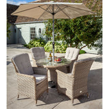2019 Hartman Heritage 4 Seat Round Garden Dining Table Set - Beech/Dove chairs and parasol on patio in front of house with large plants