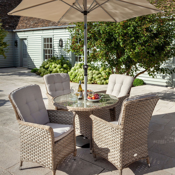 2019 Hartman Heritage 4 Seat Round Garden Dining Table Set - Beech/Dove on patio in front of house with large plants
