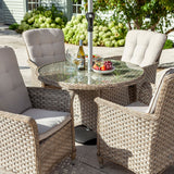 2019 Hartman Heritage 4 Seat Round Garden Dining Table Set - Beech/Dove close up of table and chairs with plants in background