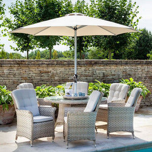 2019 Hartman Heritage 6 Seat Round Garden Dining Set with Lazy Susan - Beech/Dove on patio next to pool with brick wall and trees in background