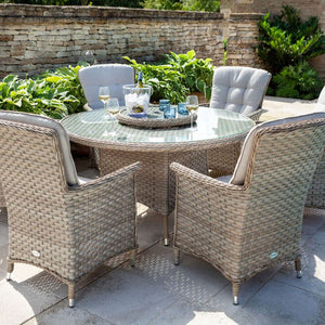 2019 Hartman Heritage 6 Seat Round Garden Dining Set with Lazy Susan - Beech/Dove chairs and table in front of brick wall and plants