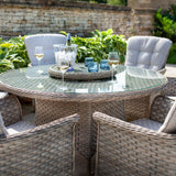 2019 Hartman Heritage 6 Seat Round Garden Dining Set with Lazy Susan - Beech/Dove chairs and table with brick wall and plants in background