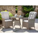 2019 Hartman Heritage Garden Bistro Set - Beech/Dove on patio in front of brick walls and plants