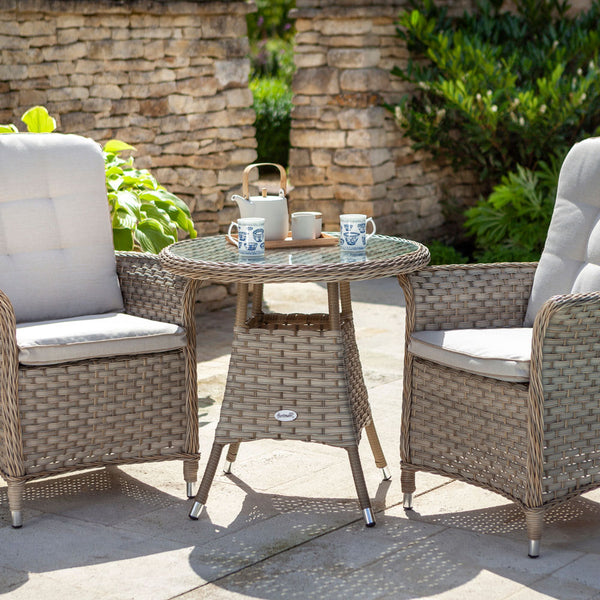 2019 Hartman Heritage Garden Bistro Set - Beech/Dove on patio with brick wall and plants in background