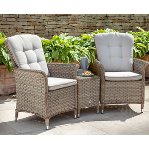 2019 Hartman Heritage Duet Garden Coffee Table Set - Beech/Dove chairs and table on patio in front of brick wall and plants