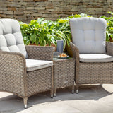 2019 Hartman Heritage Duet Garden Coffee Table Set - Beech/Dove on patio in front of brick wall and plants