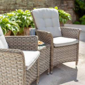 2019 Hartman Heritage Duet Garden Coffee Table Set - Beech/Dove on patio with brick wall and plants in background