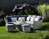 Bramblecrest Monterey Sofa Set With Mini Glass Adjustable Table & Stools in garden