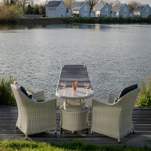 2019 Bramblecrest Monterey Garden Bistro Set With Adjustable Ceramic Table on patio in front of water with houses in background