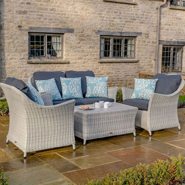 2019 Bramblecrest Monterey 2 Seater Outdoor Sofa Set With Ceramic Coffee Table on patio in front of stone brick house