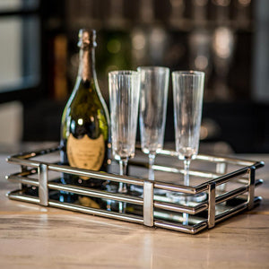 Art deco rectangular drinks tray on bar with champagne and flutes