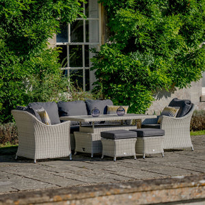 2019 Bramblecrest Monterey 3 Seat Outdoor Sofa Set With Adjustable Ceramic Dining Table on patio in front of house with plants on