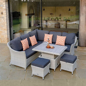 2019 Bramblecrest Monterey Outdoor Sofa Set With Adjustable Garden Dining Table on patio in front of house with large glass doors