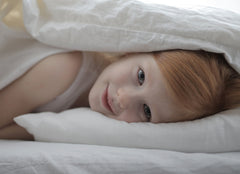 Girl hiding in bed Luna Luxury