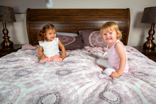 Load image into Gallery viewer, Organic-Natural-eco-friendly-cotton-sateen-quilt-cover-set-Diana-dusky-pink-king-size-two-little-girls-sitting-on-bed