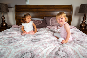 Organic-Natural-eco-friendly-cotton-sateen-quilt-cover-set-Diana-dusky-pink-king-size-two-little-girls-sitting-on-bed-image