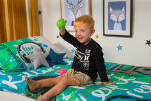 Load image into Gallery viewer, organic-cotton-quilt-cover-set-jammin-music-graffiti-speakers-green-single-display-boy sitting-holding-ball