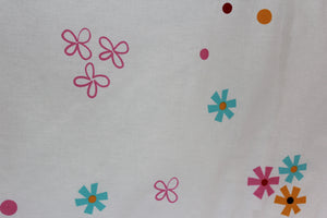 organic-natural-cotton-half-cot-bumper-colour-flowers-white-close-up-image