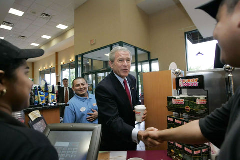 President Bush greeting immigrant works at Dunkin Donuts