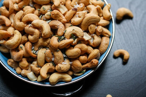 Assorted cashews in a blue bowl