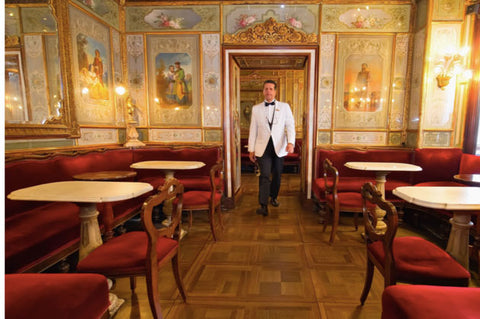 man in tuxedo in a european dining room