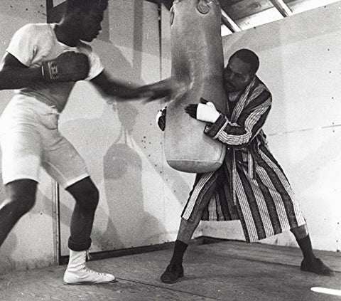 Muhammad Ali training with a boxing bag Photo Print (10 x 8)
