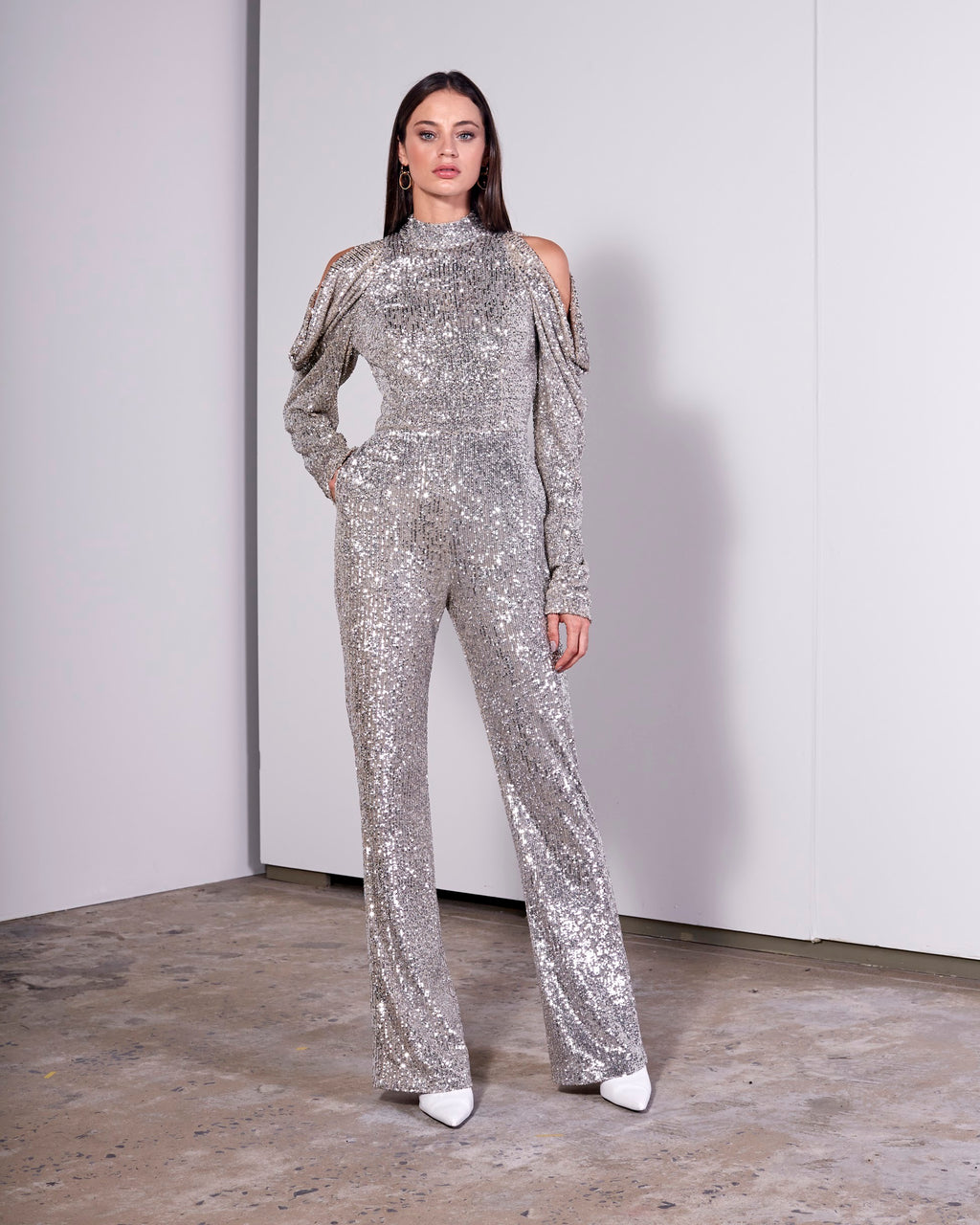 SILVER SMALL SEQUIN JUMPSUIT W/ RUFFLE LS SLEEVE & OPEN BACK