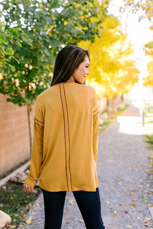 Beyond Compare Contrast Stitch Top In Mustard - ALL SALES FINAL