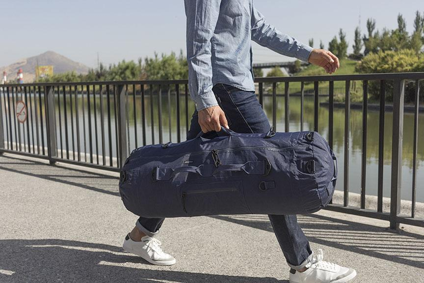 #22 cool gadgets for men: man walking with blue collapsible bag gym bag