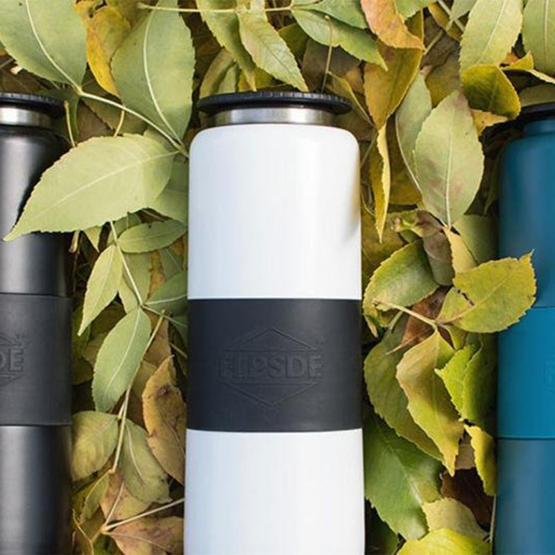 dual chamber water bottles different colours between leaves