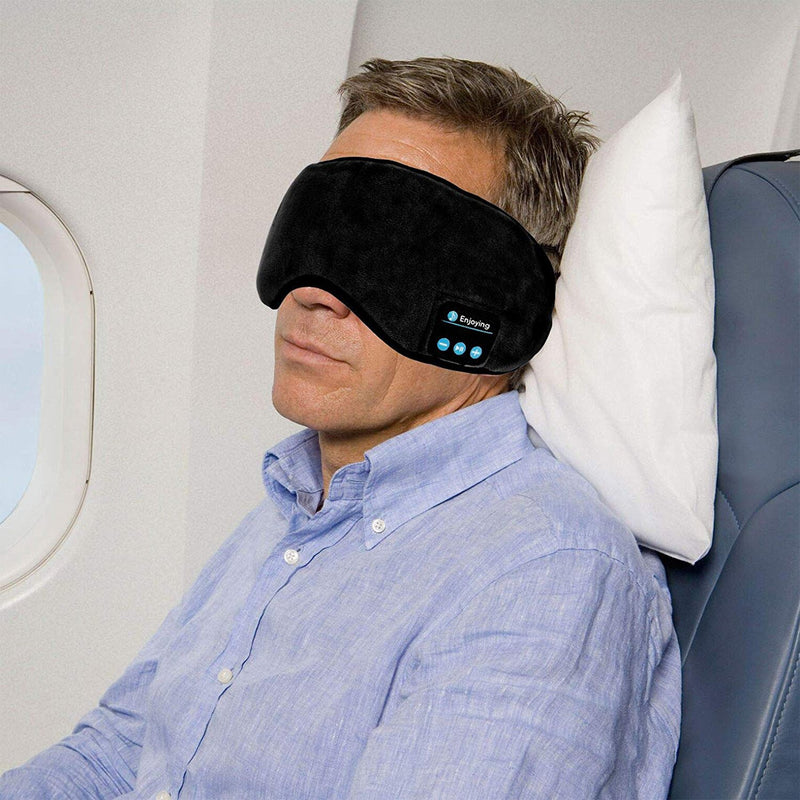 bluetooth sleeping mask lifestyle man in airplane