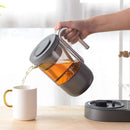 tea brewer lifestyle pouring tea